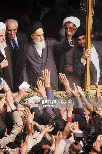 Ayatollah Khomeini being greeted by followers