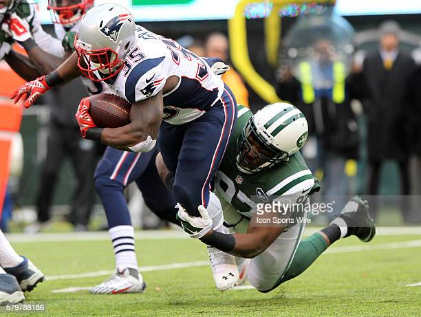 New England Patriots running back Jonas Gray is tackled by New York Jets outside linebacker Calvin Pace during a NFL game between the New England...