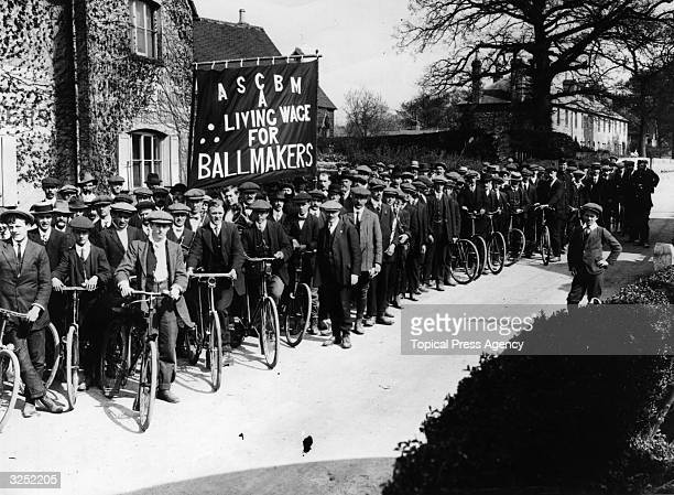 A group of strikers from the Association of Cricket Ball Makers congregate outside the headquarters of Duke Sons in Kent