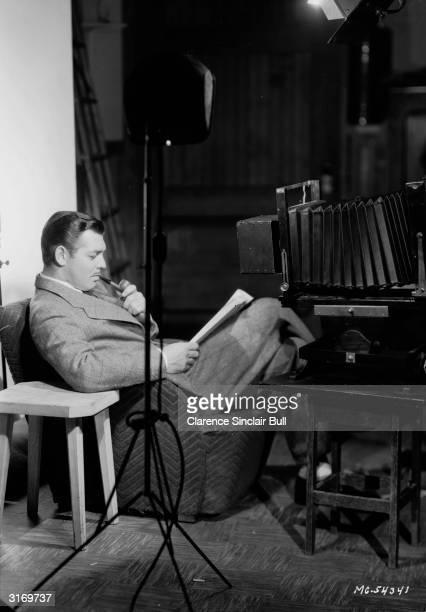 American actor Clark Gable relaxing on set