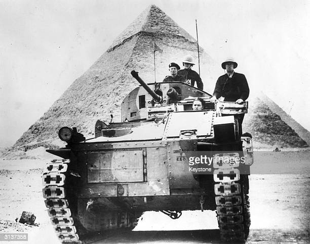 A British tank set against a background of one of the Egyptian pyramids during World War II