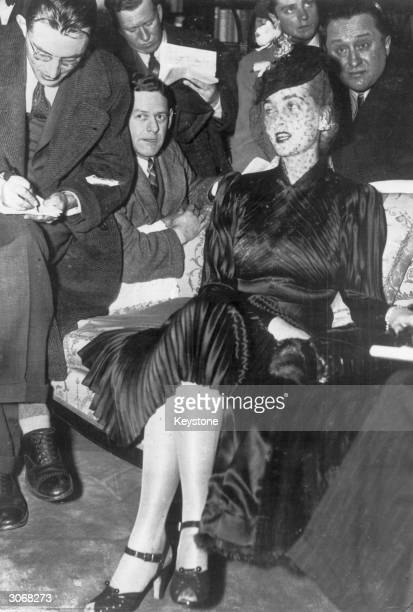 American socialite and Woolworth heiress Barbara Hutton is interviewed by journalists on her arrival in New York aboard the 'Aquitania'