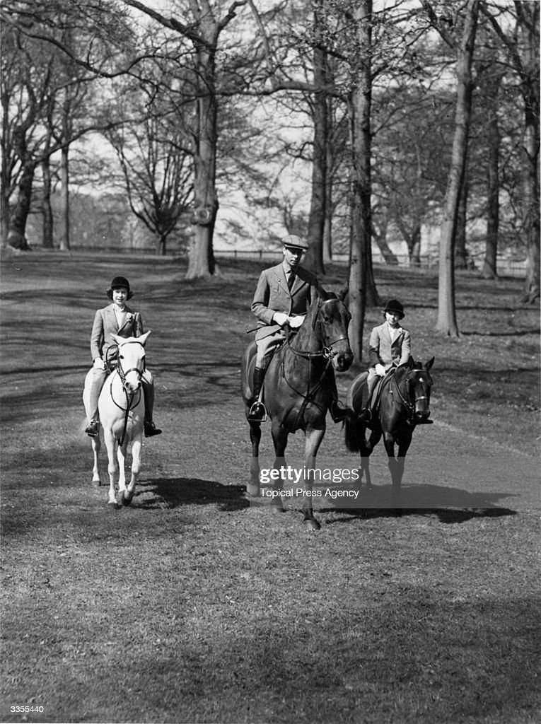 Princess Elizabeth and Princess Margaret (1930 - 2002) riding along with their father, King George VI, on the future Queen's 13th birthday.
