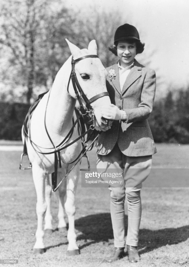 Princess Elizabeth with a horse at Windsor on her 13th birthday.