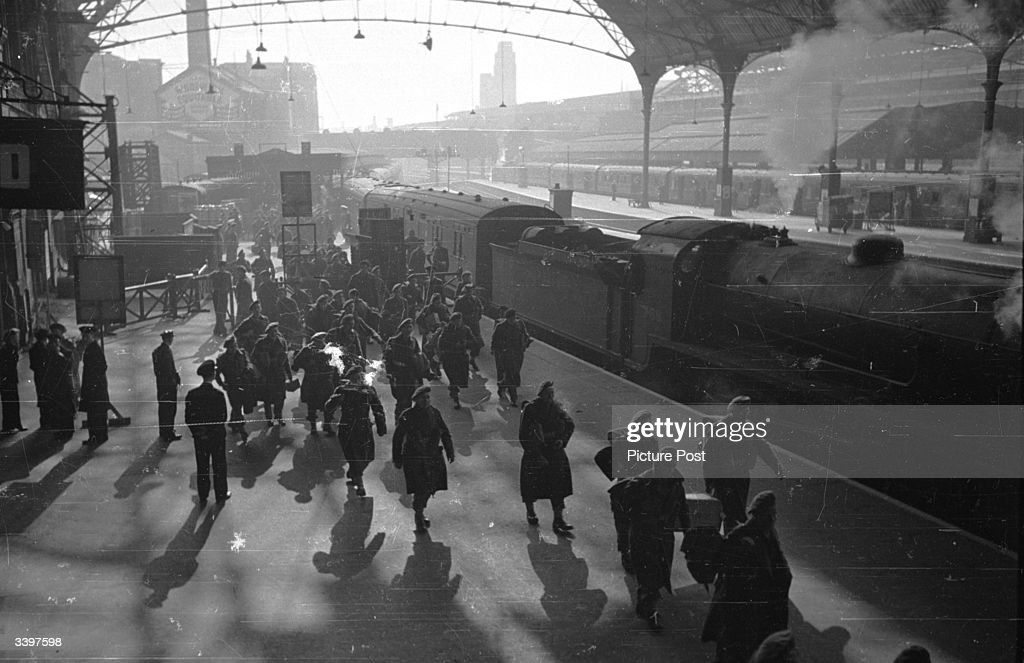 Soldiers returning to their friends and family at a London railway station. Original Publication: Picture Post - 1953 - How To Welcome A Soldier Home - pub. 1945