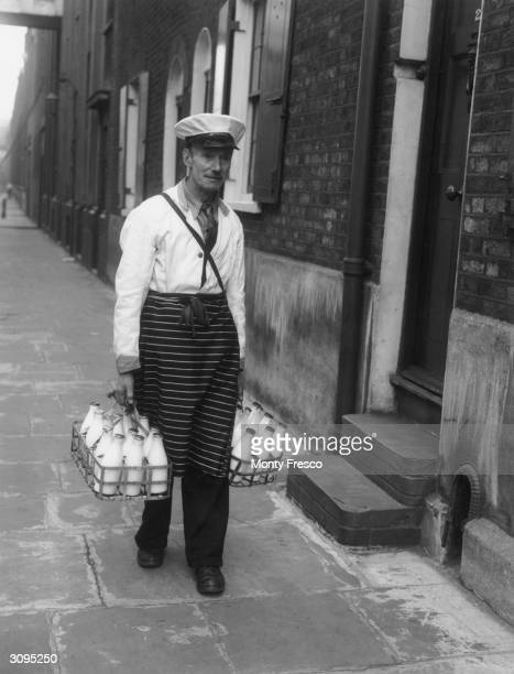 A milkman delivering bottles of milk during his morning round