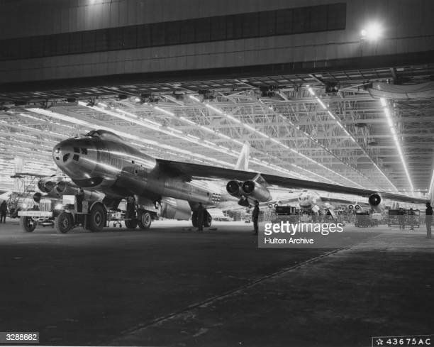 A completed B47 Statojet airplane being rolled off the assembly line at Boeings Airplane Company's Wichita Kansas plant