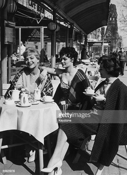 Three actresses sit at a pavement cafe in Berlin