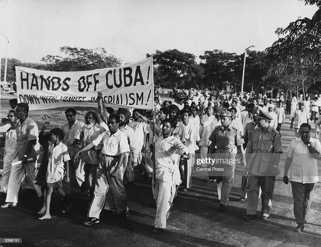 Members of the Indian Communist Party marching to the American embassy to protest at US intervention in Cuba, during the Bay of Pigs invasionn. The demonstrators later stoned the embassy building.