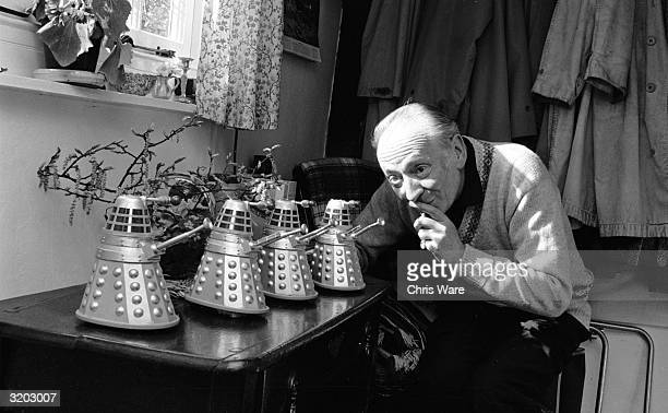 British actor William Hartnell at home in Mayfield Sussex with four miniature model Daleks arch enemies of Hartnell's character Dr Who in the BBC's...