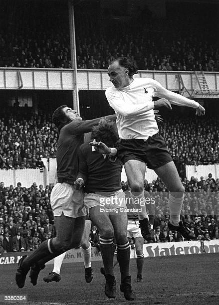 Tottenham Hotspur's Alan Gilzean challenges Leicester City's goalkeeper Peter Shilton for the ball in the air