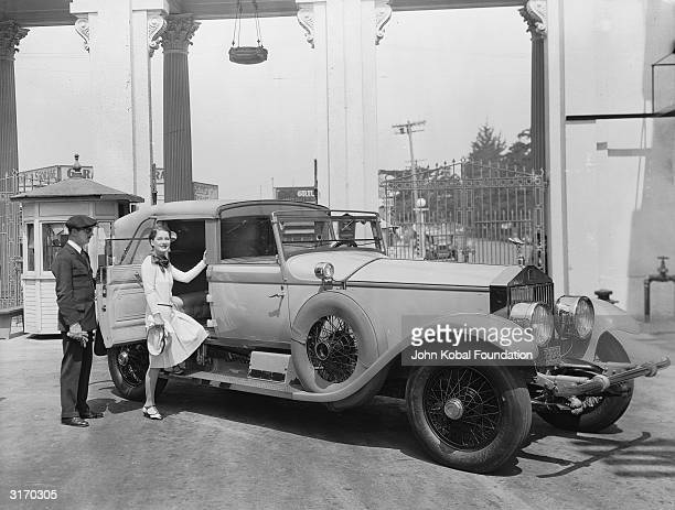 Canadian actress Norma Shearer born Edith Norma Shearer steps into a luxurious car She won an Oscar for her role in the 1930 MGM film 'The Divorcee'