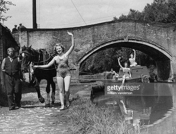 A party of women enjoying a holiday on a horsedrawn barge on the Shropshire Union Canal