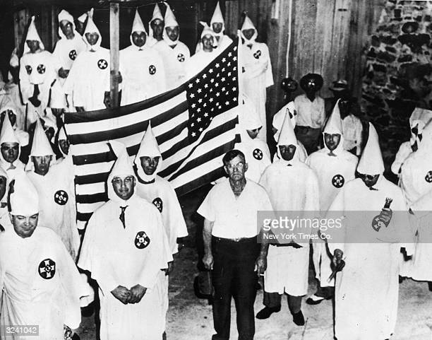 Group portrait of the fiftyeight Ku Klux Klan members who marched with their faces uncovered in accordance with a new state law through Pell City...