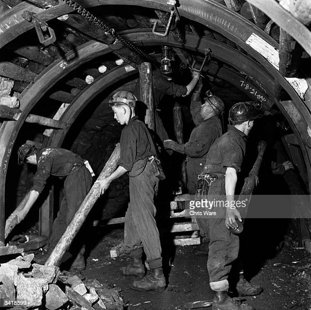 Teenage boys studying at the National Coal Board's school at Dungavel House in Lanarkshire learning how to erect pit props in a tunnel at a nearby...