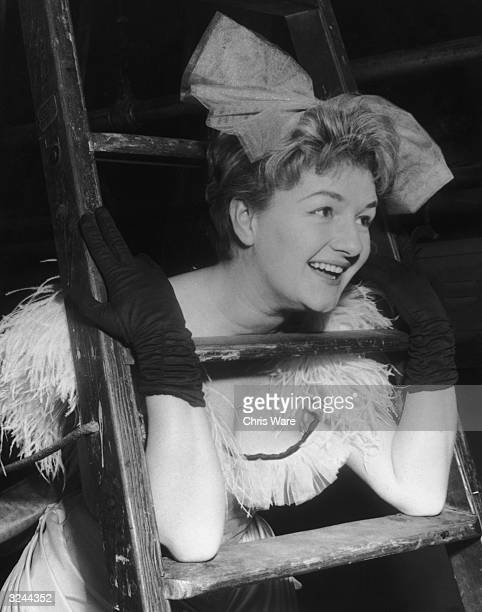 English actress Joan Sims rehearsing on stage for the new revue show entitled 'The Lord Chamberlain Regrets..' at the Saville Theatre, London.