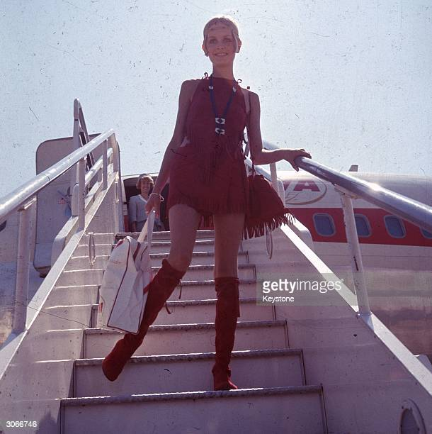 British fashion model Twiggy born Leslie Hornby disembarks from an aircraft at London Airport