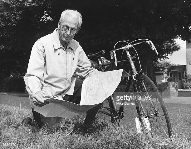 Arthur Batt a keen cyclist using a map to plan a week's cycling holiday in Suffolk He cycles some 200 miles a week