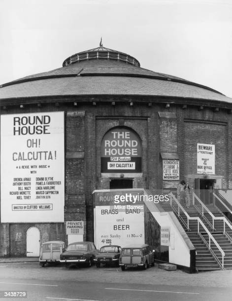 The Round House theatre in Chalk Farm north London Banners on the side advertise the risque revue 'Oh Calcutta' and a regular Brass Band Beer...