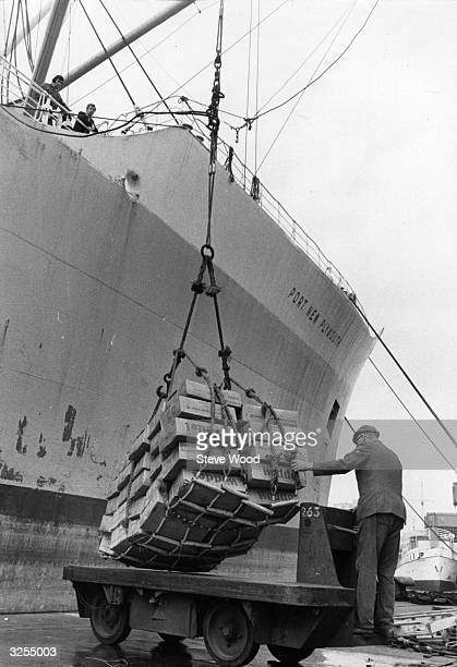 A scene from the Royal Albert Docks London where cargo is being unloaded