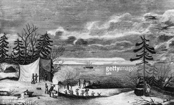 21st December 1620 The pilgrim fathers make camp at Plymouth Colony upon their arrival in America Their ship the Mayflower lies at anchor in the bay...