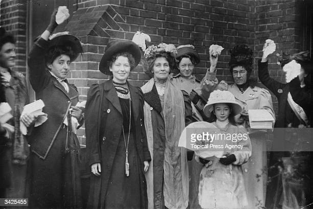 English suffragettes Emmeline Pankhurst and her daughter Christabel Harriette third from left are welcomed by friends and supporters upon their...