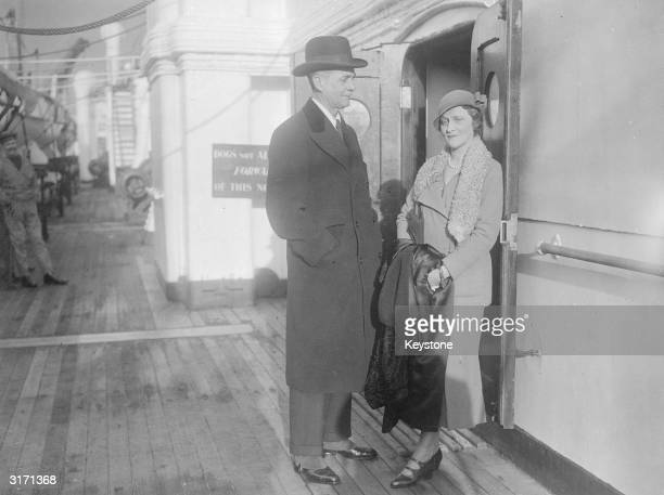 Lord and Lady Astor, Waldorf and Lady Nancy , arriving at Southampton on the Cunard liner SS Berengaria, from the United States.