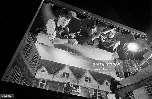 Boys from the puppet club get to grips with their marionets at Stowe Public School Buckinghamshire Original Publication Picture Post 4275 A School...
