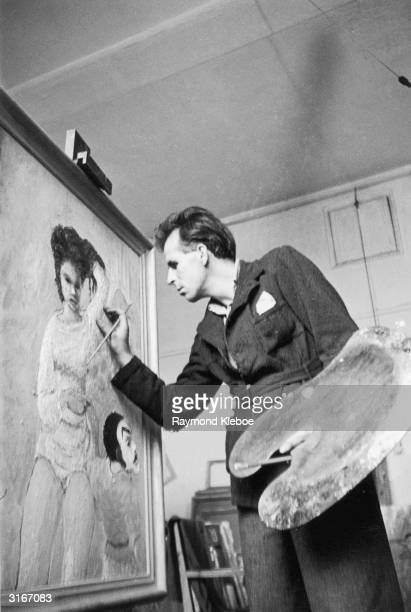 English author and artist Mervyn Peake at work on a canvas Original Publication Picture Post 4276 An Artist Makes A Living pub 1946