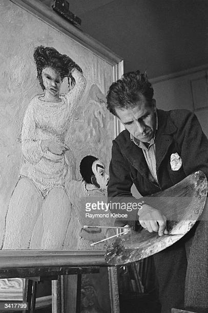 English author and visual artist Mervyn Laurence Peake at work on a canvas Original Publication Picture Post 4276 An Artist Makes A Living pub 1946