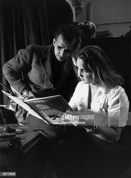 Illustrator and novelist Mervyn Peake watches with rapt attention as his companion reads from a children's book Original Publication Picture Post...