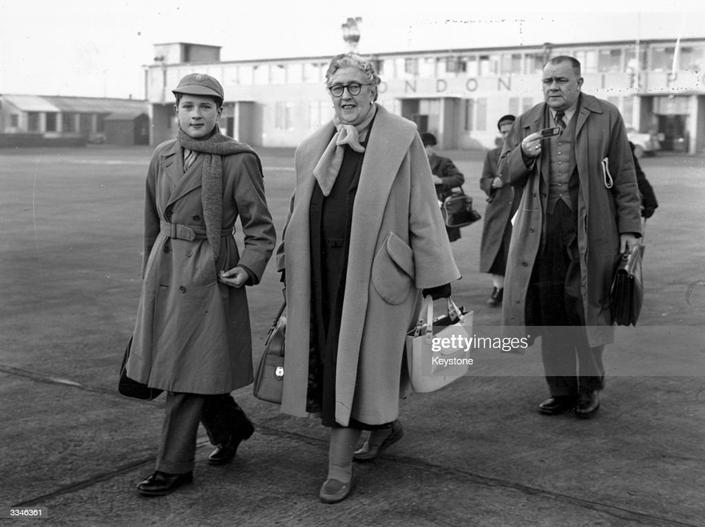 English crime writer Agatha Christie (1890 - 1976) at London Airport with her grandson, Matthew Pritchard.