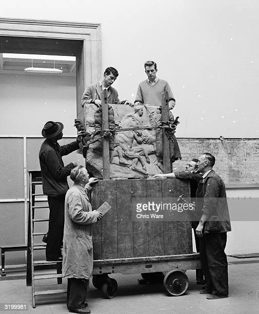 Workmen unload a portion of the Parthenon frieze before affixing it to the wall in the new Elgin Marbles room of the British Museum, London.