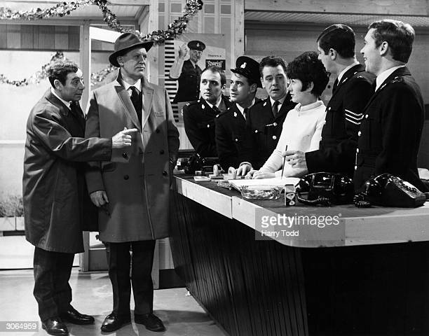 On the left John Slater introduces the new Detective Inspector played by Joss Ackland to the staff at the police station in the TV series Z cars...