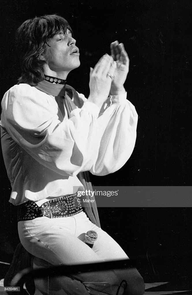 Singer Mick Jagger of British rock group the Rolling Stones on stage at London's Lyceum Ballroom.