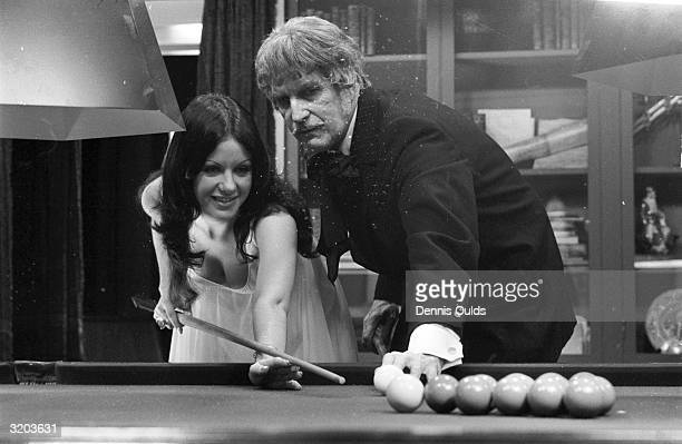American actor Vincent Price playing snooker with former Miss Australia Valli Kemp at Elstree Studios during filming of 'Dr Phibes Rises Again' Both...