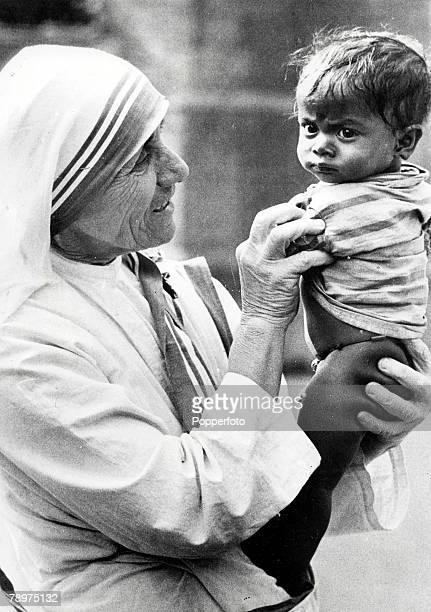 21st December 1971 Mother Sister Theresa who run the Sisters of Charity mission in Calcutta pictured holding a small child