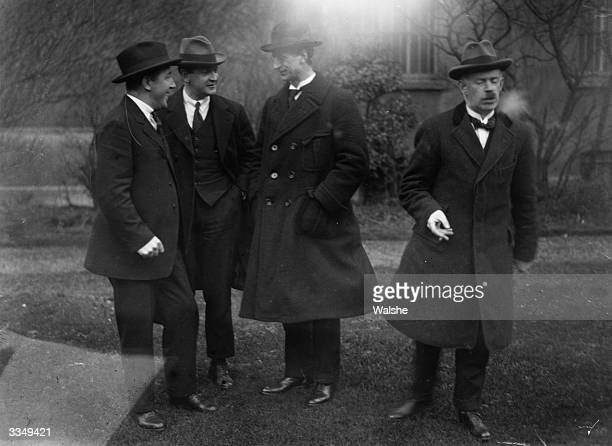 Members of the Sinn Fein Ard Fheis from left to right Harry Boland Michael Collins Eamon de Valera and Eamon Duggan Collins is also the Minister for...