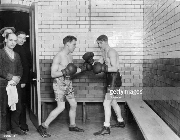 Boxers Teddy Baldock and Jim Briley during an exhibition bout at Manor Place Baths Walworth in aid of the Mayor of Southwark's Crippled Children and...