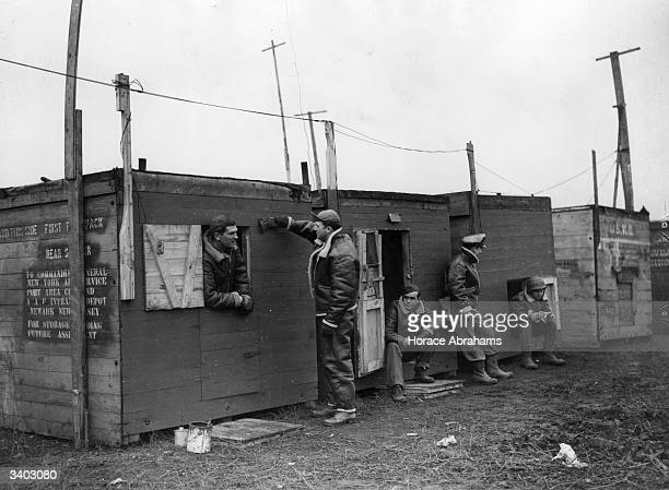 Men of the US Air Corps have improvised new billets for themselves from equipment crates Gliders and other vital pieces of equipment have been...