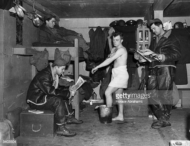 Men of the US Air Corps have improvised new billets for themselves from equipment crates Hygiene facilities however could still find room for...