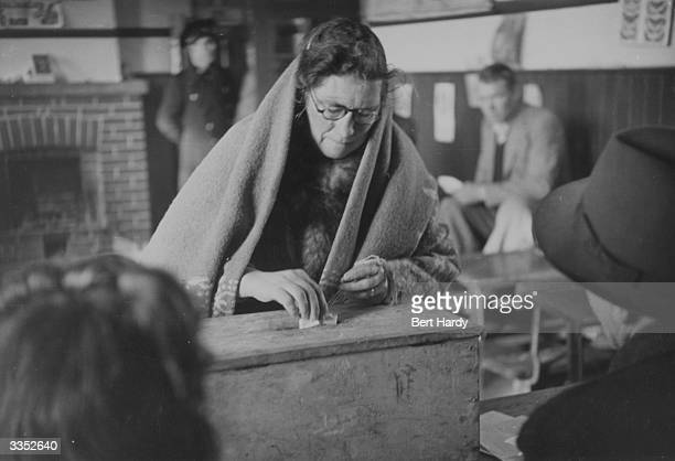 An Irish woman casts her vote in the 1948 General Election. Original Publication: Picture Post - 4511 - Eire Takes Hobson's Choice - pub. 1948