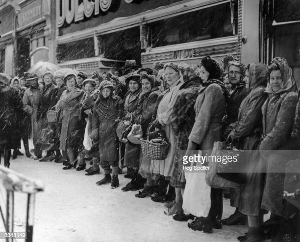 Shoppers still queuing despite the snowfalls in Catford London
