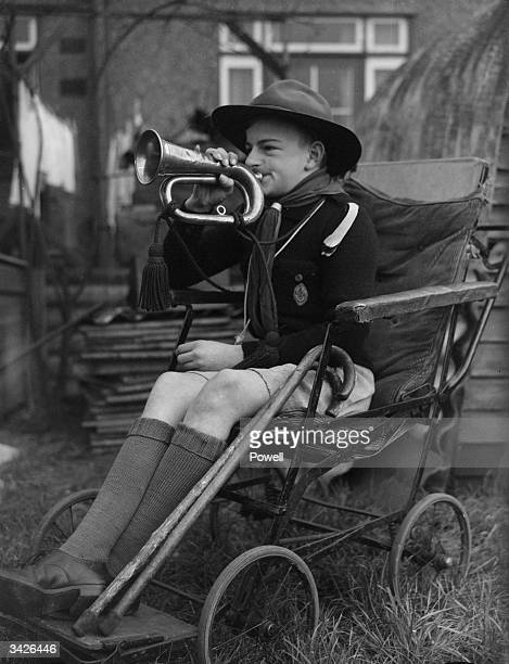 Michael Lee a disabled scout blowing a bugle