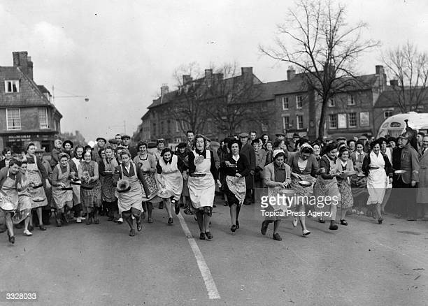 The start of the 1950 pancake race for housewives in Olney, Buckinghamshire.
