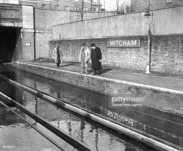 The River Wandle overflows and floods Mitcham Station in south London.