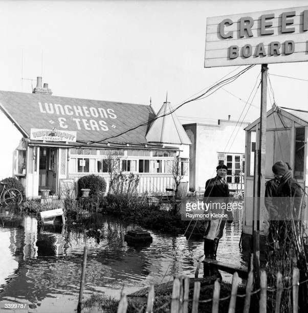 Floodwater outside a cafe on Canvey Island during flooding Original Publication Picture Post 6423 Floods Return To Canvey Island One Man's Story pub...