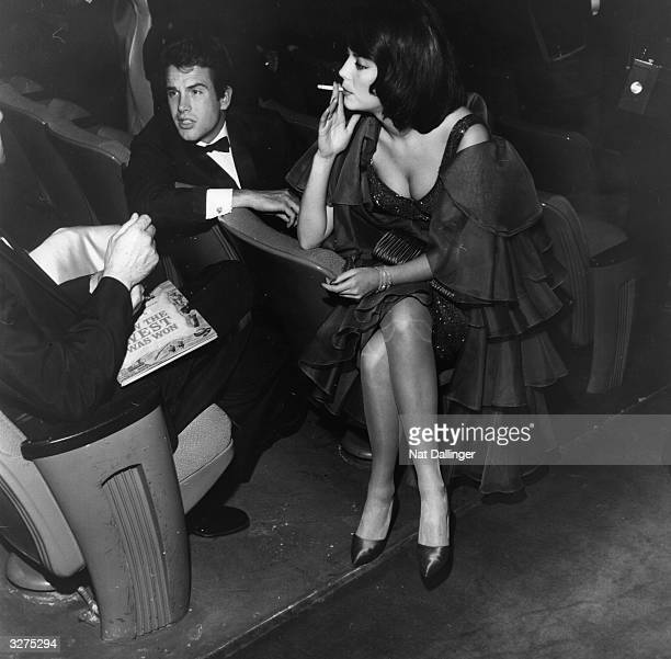 Warren Beatty American actor and actress Natalie Wood at the American premiere of the film 'How the West was Won' being held at the Warner Theatre