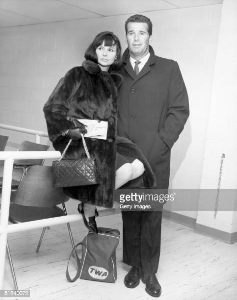 21st February 1964, American actor James Garner and his wife, Lois Clarke, inside John F Kennedy airport prior to boarding a flight for England, New...