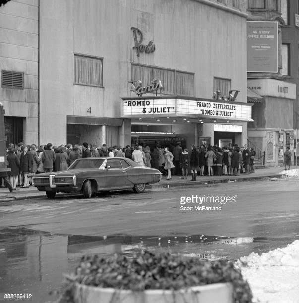 Large crowds of people gather outside the Paris Movie Theater on 58th Street in Manhattan to see Franco Zeffirelli's Romeo and Juliet